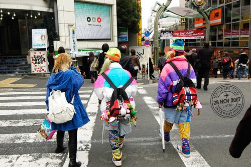 Harajuku teenagers crossing the road leading to Takeshita Dori
