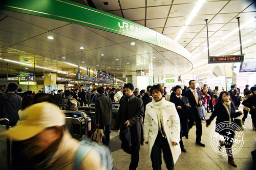 Shinjuku station crowd rushing during the peak hour